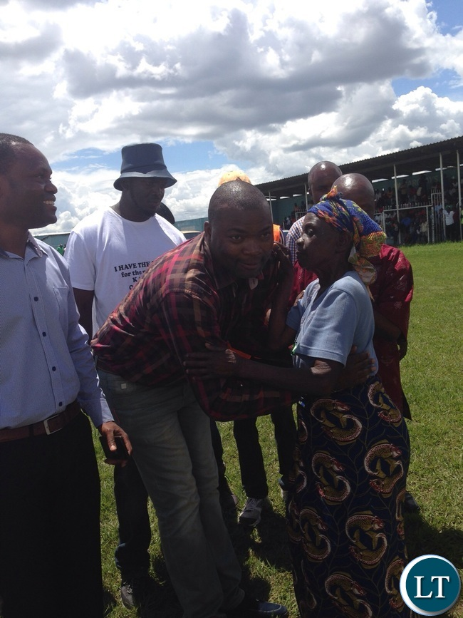 Mr Lusambo hugs one of the elderly receipient of the donated items
