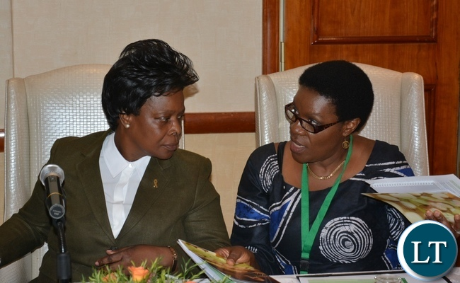 Self Help Africa Country Director Kalongo Chitengi shares the booklet with First Lady Esther Lungu at the Policy to Practice Policy Dialogue Forum at Sothern Sun Hotel