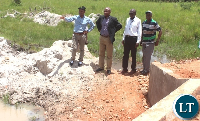 Government through Disaster Management and Mitigation Unit (DMMU) has constructed a Bridge in Kabwe's Kalwelwe area in the out-skirts of Kabwe. In the Picture, Area MP Sydney Mushanga (left) with his entourage checking on the Bridge