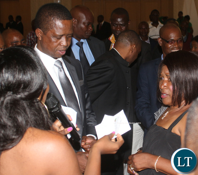 President Edgar Chagwa Lungu with Mrs Grace Chabu after handing over a note of her pledge.