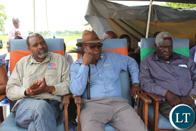 Chief Hamusonde of the Monze District (Right in a brown hat) and Chieftainess Choongo's Ngambela Tyson Haamamba (left) watch proceedings during the official opening of Muunyumabisi Health Post in Monze District by Deputy Minister of Health Dr Chitalu Chilufya
