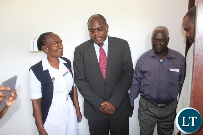 Muunyumabisi Health Post Sister –In-Charge Mambo Hacheenyu(left) leads Deputy Minister of Health Dr Chitalu Chilufya(right) during the inspection of the health facility which the Minister commissioned yesterday in Monze District.
