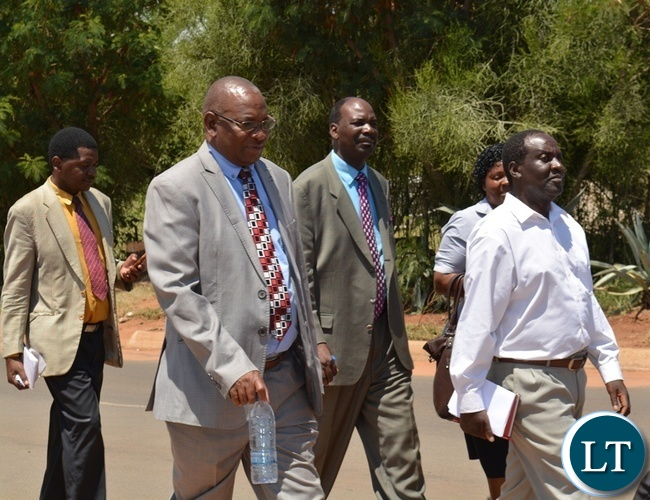 SDA South Zambia Conference president Maxwell Muvwimi (second from left), Livingstone district planning officer Elvis Siyauya (right) and South Zambia Conference executive secretary Clive Kashweka (middle) matching during the official opening of Victoria Falls Adventist Primary School in Livingstone