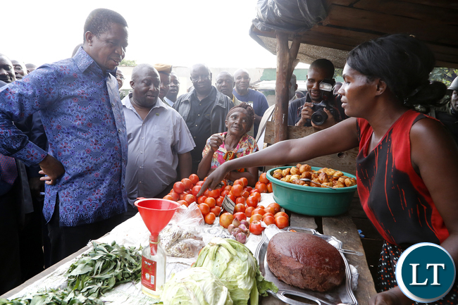 President Edgar Chagwa Lungu buys Tradition vegetables at Baluba Road Side Market on Ndola - Kitwe Dual High Waythe First Family stopped over to Meet Traders and Exchanges Views 16-01-2016, PICTURE BY EDDIE MWANALEZA/STATEHOUSE