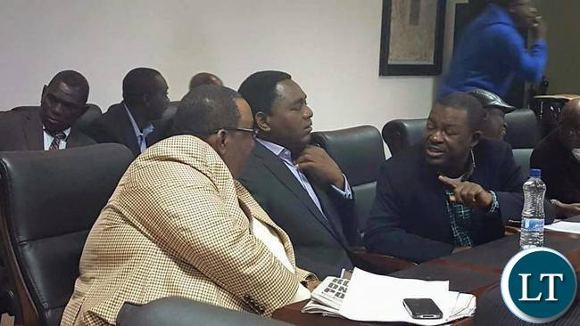 RAINBOW Party leader Wynter Kabimba speaks to UPND leader Hakainde Hichilema and his vice president Godfrey Bwalya at joint press conference by various opposition Political Parties among them Rainbow Party,UPND, ADD, Peoples Party, Green Party, UPP and NDP.