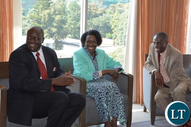 Vice President Inonge Wina with her Deputy Minister Lowrance Sichalwe and Permanent Secretary Simon Miti having a light Moment shortly before meeting with donors at Intercontinental Hotel