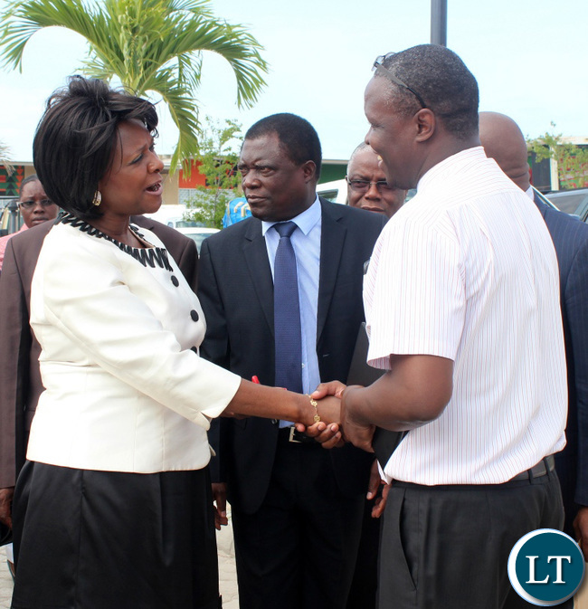Commerce Minister Margaret Mwanakatwe being welcome by Shoprite General Manager Charles Bota on arrival for official opening of Shoprite Barotse shopping Mall in Mongu District of Western Province