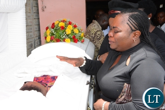 ZANIS Head of Photographic Section Emmah Nakapizye pay her last respect to her best Friend late ZNBC staff Faith Kandaba at the Church Service at Saint Pauls Catholic in Lusaka
