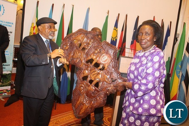 VICE President Inonge Wina receives a gift from African Regional Labour Administration Centre (ARLAC) Vice Chairperson Dr. Chris Ngige after giving her speech at Avani Victoria Falls Resort in Livingstone