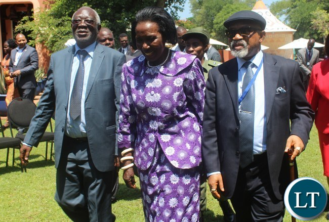 VICE President Inonge Wina (c), flanked by Labour & Social Security Minister Fackson Shamenda (l) and African Regional Labour Administration Centre (ARLAC) Vice Chairperson Dr. Chris Ngige at Avani Victoria Falls Resort in Livingstone