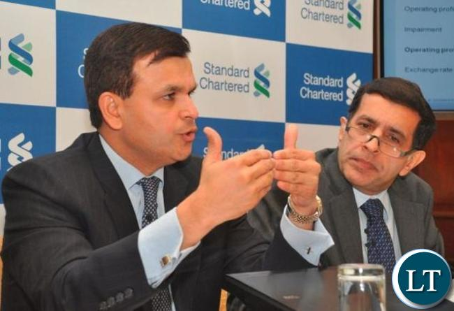 Standard Chartered Bank chief executive officer for Africa and the Middle East, Sunil Kaushal (L)