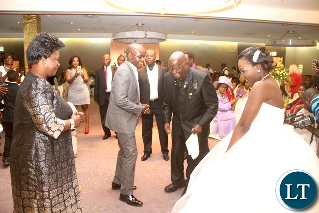 First Lady Esther Lungu and Dr Kenneth Kaunda join Masuzgo Kaunda Junior (grandson son of Dr Kaunda) and Makomba Silwamba (daughter of Eric Silwamba) on the dance floor during the wedding ceremony at InterContinental Hotel in Lusaka