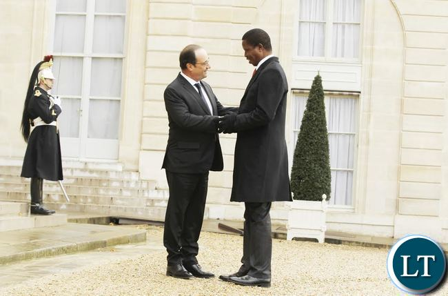 President Edgar Chagwa Lungu (right) being welcomed by French President Francois Hollande at Elysee Palace in Paris, France on Monday,February 8,2016. PICTURE BY SALIM HENRY/STATE HOUSE ©2016.