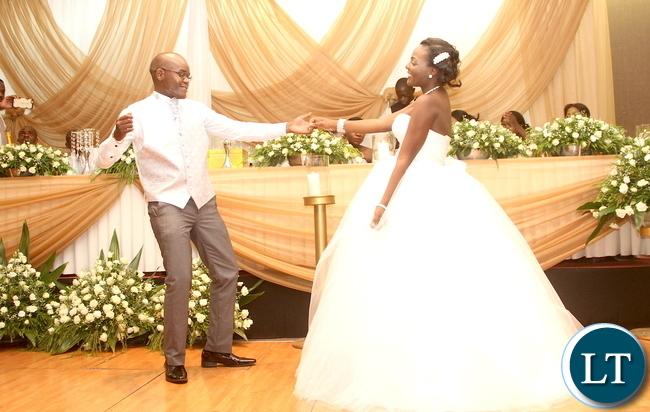 Masuzgo Kaunda Junior (grandson son of Dr Kenneth Kaunda) and Makomba Silwamba (daughter of Eric Silwamba) take to the floor