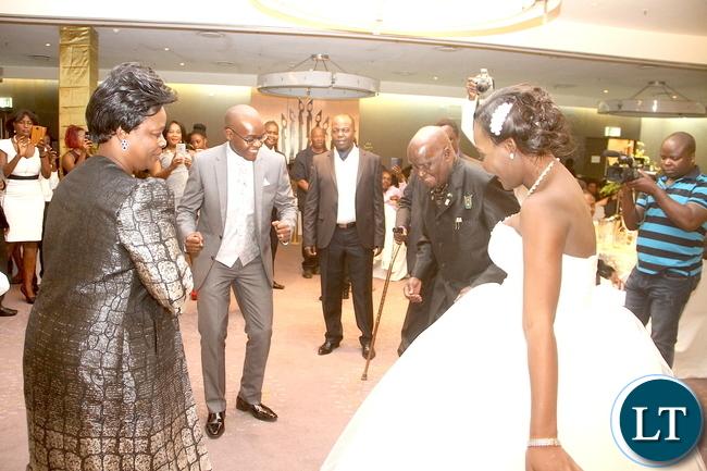 First Lady Esther Lungu and Dr Kenneth Kaunda join Masuzgo Kaunda Junior (grandson son of Dr Kaunda) and Makomba Silwamba (daughter of Eric Silwamba) on the dance floor during the wedding ceremony at InterContinental Hotel in Lusaka
