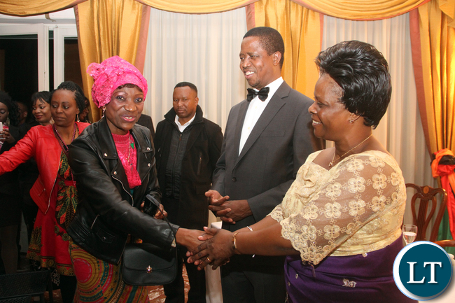 First Lady Esther Lungu greets one of the Zambian's living in Italy during dinner hosted for the President by Zambia's Ambassador to Italy Gertrude Mwape  in Rome on Friday, February 6,2016 -Picture by THOMAS NSAMA