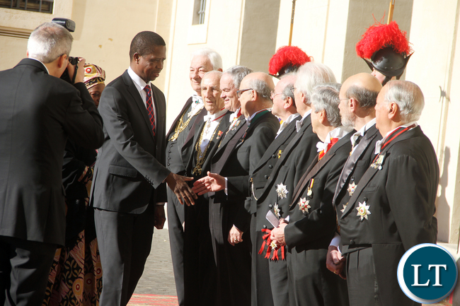 President Lungu greets Vatican staff on arrival at Vatican where he met the Pope on Feb 5,2016 -Picture by THOMAS NSAMA