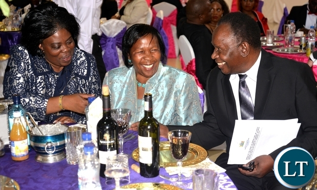 HEALTH Minister Joseph Kasonde (right), his wife, Mary (middle) with Tourism and Arts Minister Jean Kapata share a light moment during the wedding reception of Home Affairs Minister Davies Mwila's daughter Leah, at Zambia Air Force officers' mess in Lusaka on Saturday evening