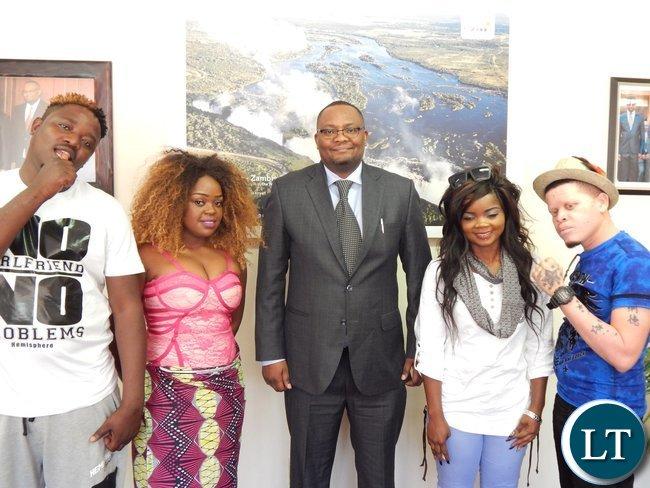 Moses N'gandwe (Chester), Mirriam Mukape (Mampi), Dambisa Lunda (Dambisa) and Bernard Katiyo (Za Yellow) with His Excellency Mr. Emmanuel Mwamba at his office in Pretoria