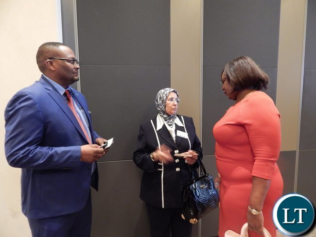 Zambia's High Commissioner to South Africa His Excellency Mr. Emmanuel Mwamba, African Union Commissioner Dr. Elham Ibrahim and Zambia's Energy and Water Development Minister Ms. Dora Siliya exchanging notes at the Africa Energy Conference in Johannesburg