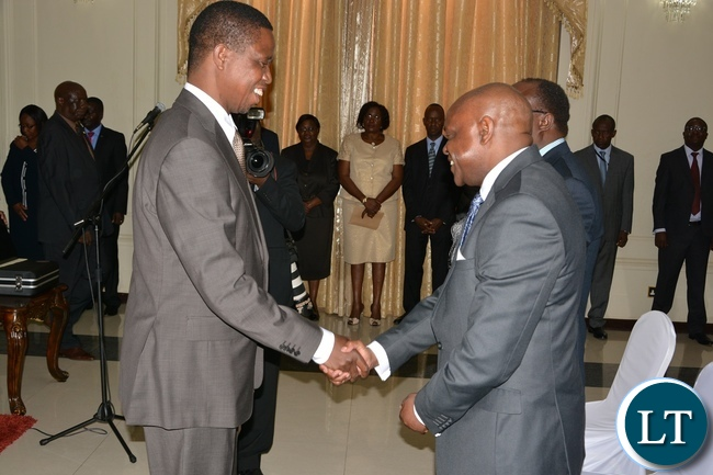 President Edgar Lungu congratulates Newly Sworn in Supreme Court Judge Justice Charles Kajimanga at State House during the swearing in ceremony of the Supreme Judges