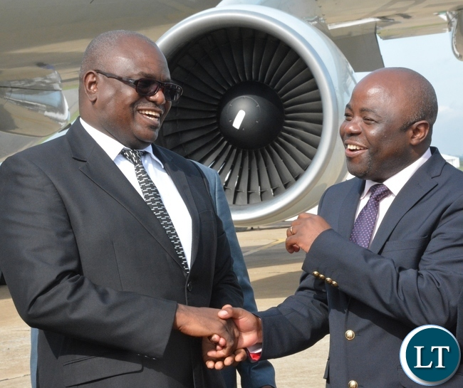 Speaker of the National Assembly Patrick Matibini(l) having a light moment with Minister of Local Government and Housing Stephen Kampyongo(r) just after seeing off Chairman of the Standing committee of the National peoples congress of China H.E Zhang Dejiang at KK airport