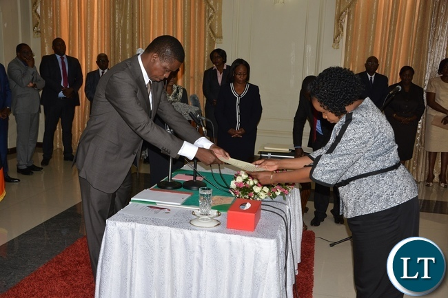 President Edgar Lungu receive latter of Orth from Newly sworn in Supreme Court Judge Jane Kazor Kabuka at State House during the swearing in ceremony of the Supreme Judges