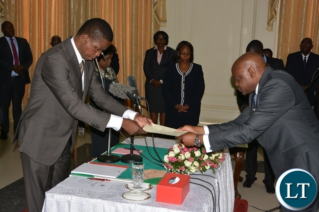 President Edgar Lungu receive latter of Orth from Newly sworn in Supreme Court Judge Charles Chinyama at State House during the swearing in ceremony of the Supreme Judges