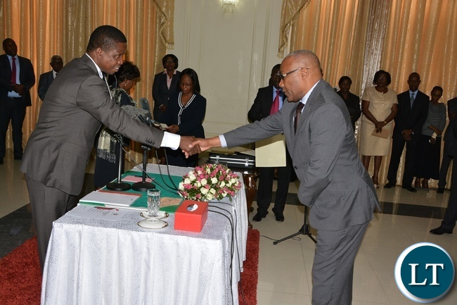 President Edgar Lungu congratulates Newly Sworn in Supreme Court Judge Justice Nigel Mutuna at State House during the swearing in ceremony of the Supreme Judges