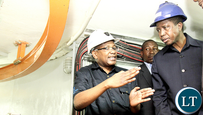 President Edgar Chagwa Lungu (right) listens as ZESCO Managing Director Victor Mundende explains how Hydro Power is generated during the commissioning of 120MW Itezhi Tezhi Hydro Power Station in Itezhi Tezhi Central Province on Friday,March 4, 2016. PICTURE BY SALIM HENRY/STATE HOUSE ©2016.