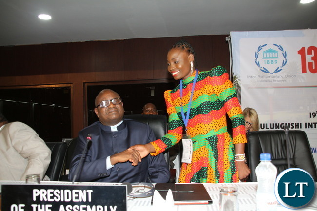 Catherine Phiri being congratulated by the National Assembly of Zambia Dr Patrick Matibini after addressing the 134th IPU Assembly General debate at Mulungushi International Conference Center