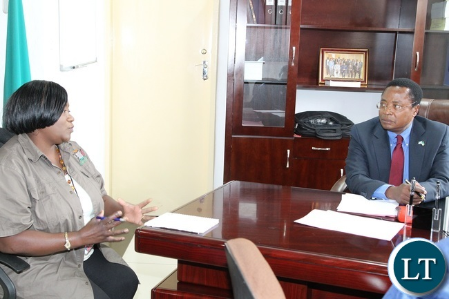 Assistant Director Information and Communication cabinet office,Coreen Mvula,confers with Community Development and Social Welfare Permanent Secretary,Dr.Denny Chikamata when she paid a courtesy call on him on matters of decentralisation.