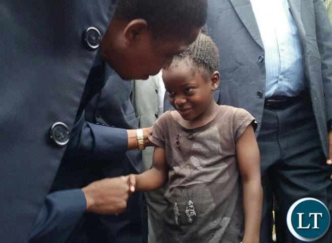 President Lungu talking to a girl child when arrived in Itezhi Tezhi