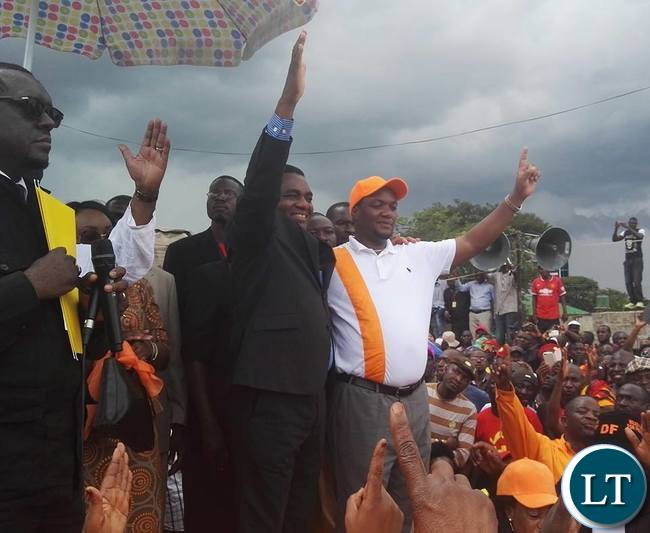 UPND leader Hakainde Hichilema and Democratic Front leader Miles Sampa gesture to their supporters who came to witness the signing of an election pact between UPND and DF.