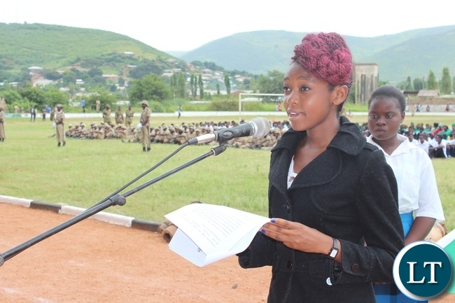 Eighteen years Bertha Chulu, reads a speech on behalf of fellow youth at this year's Youth Day commemorations held at David Kaunda stadium in Chipata on Saturday. PICTURE BY STEPHEN MUKOBEKO/ZANIS