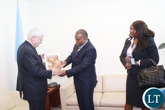 Zambia Air Force Commander Lieutenant General Eric Chimese presents a gift to UN Under-Secretary General for peacekeeping Operations Hervé Ladsous (l) at United Nations Headquarters in New York on Monday 25 April, 2016. On the right is Zambia UN Ambassador Dr Mwaba Kasese-Bota. PHOTO | Capt. Michelle Mwiza Kayanda | ZAF