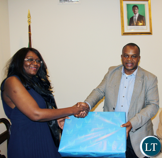 Zambia Air Force Commander Lieutenant General Eric Chimese (r) presents a gift to Zambia UN Ambassador Dr Mwaba Kasese-Bota in New York on Wednesday 27 April, 2016. PHOTO | CHIBAULA D. SILWAMBA | ZAMBIA UN MISSION