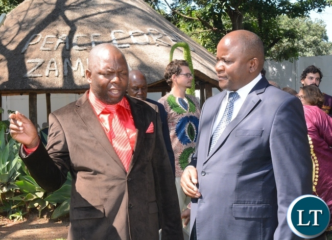 His Royal Highness Chief Chamuka of Chisamba District(l) having a light moment with Lands,Natural Resources and Environmental Protection Deputy Minister Davis Mwango(r) immediately after the swearing in ceremony for rural aquaculture promotion and linking income,food and environment project volunteers