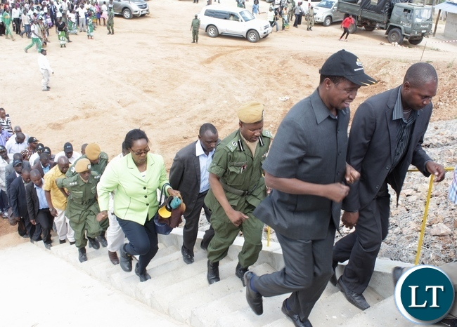 President Edgar Lungu (l) runs to climb the stairs to the Sioma Bridge during the official commissioning of the bridge built at a cost of K108.2million in Sioma District of Western Province