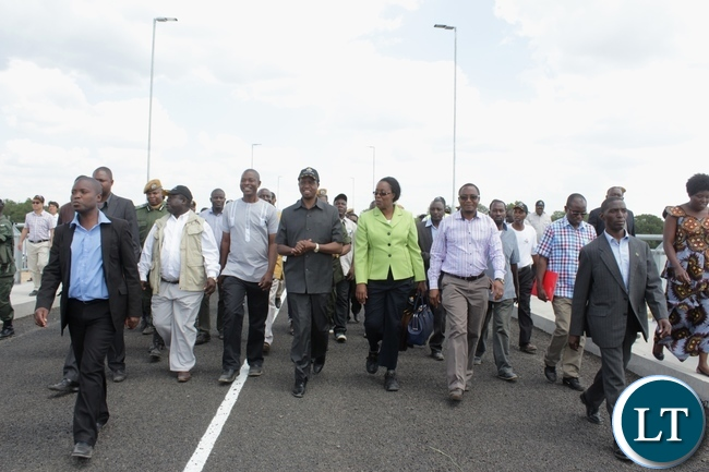 President Edgar Lungu (c) flanked by his entourage tours the Sioma Bridge built at a cost of K108.2million after officially commissioning it in Sioma District of Western Province,