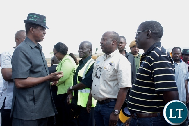 President Edgar Lungu (l) talks to Road Transport and Safety Agency (RTSA) Director Soko Zindaba (c) at the official commissioning of the Sioma Bridge built at a cost of K108.2million after officially commissioning it in Sioma District of Western Province