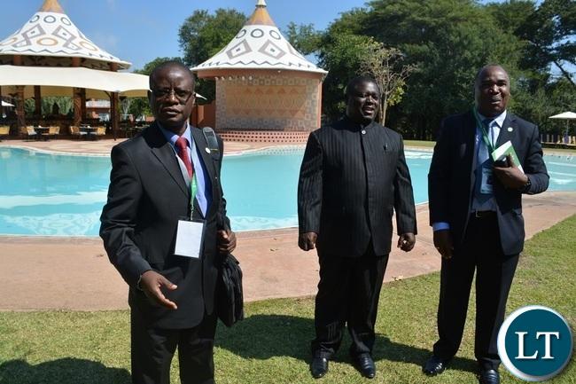 Works and Supply Minister Yamfwa Mukanga (middle), EIZ president Bernard Chiwala (left) and former University of Zambia (UNZA) Vice Chancellor Stephen Simukanga (right) at AVANI Victoria Falls Hotel y