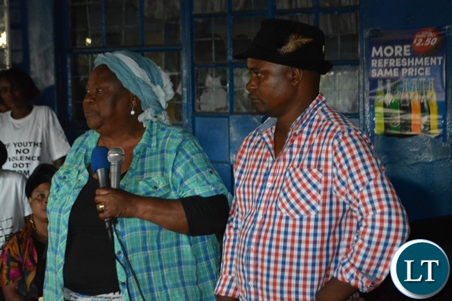 PF provincial Chairlady Alice Simango(left) addressing  the gathering while PF Southern Province mobilisation chairman Brave Mwetwa (right) during the launch of the District Mobilisation Campaign in Livingstone