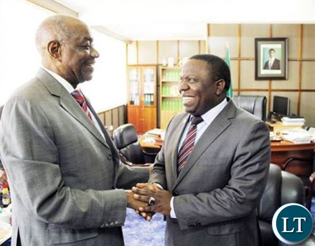 VJ shaking hands with Harry Kalaba during a recent meeting  at the Ministry of Foreign Affairs