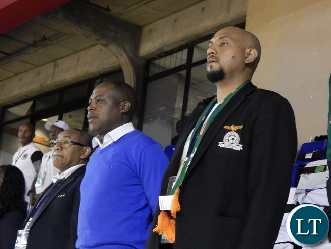 Right - Left: Delegation leader Lee Kawanu, former FAZ president Kalusha Bwalya and Confederation of African Football (CAF) Madagascar Organising Committee president Ahmad Ahmad during the Zambian and Tunisian national anthems before the start of the game at Ellis Park Arena, Johannesburg, South Africa