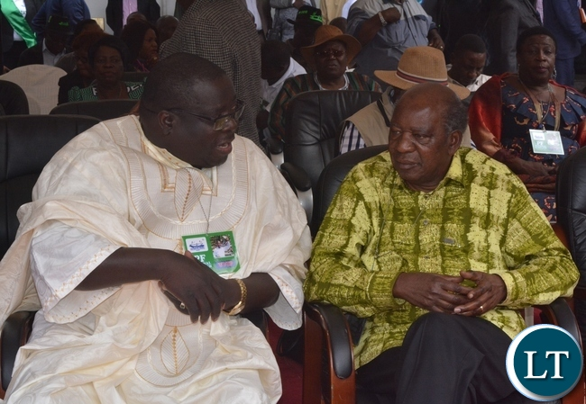 -Minister of Information and Broadcasting Services Chishimba Kambwili(l) and Minister of Finance Alexander Chikwanda(r) chats during the Launch of the PF Campaign at Heroes Stadium