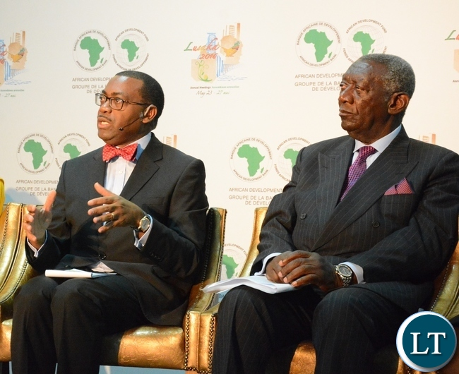 African Development Bank President Akinwumi Adesine speaking whilst former President of Ghana John Kufour listens at the Achieving Nutritional Security conference