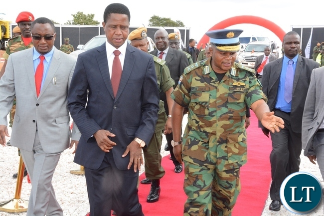 ZAF Commander Eric Chimese welcomes President Edgar Lungu at the official the ground breaking ceremony of ZAF twin Palm Public Private Partnership Project on Support Social Amenities and Commercial Facilities whilst Lt Muwindwa Liusha helps at the launch