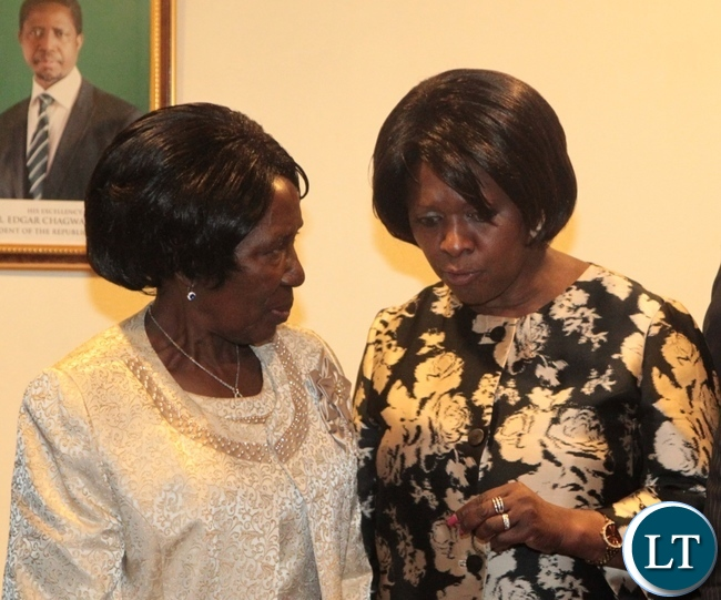 Vice President Inonge Wina(l) having a light moment with Minister of Commerce,Trade and Industry Margaret Mwanakatwe(r) during the launch of the Zambian Chapter of Zambia-South Africa Business Council at Pamodzi Hotel in Lusaka