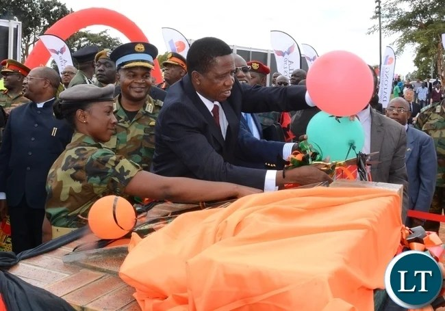 President Edgar Lungu cutting the ribbon to officially the ground breaking ceremony of ZAF twin Palm Public Private Partnership Project on Support Social Amenities and Commercial Facilities whilst Lt Muwindwa Liusha helps at the launch